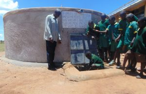The Water Project:  Students Fetch Water From Their Tank