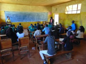 The Water Project:  Students Listen During Training