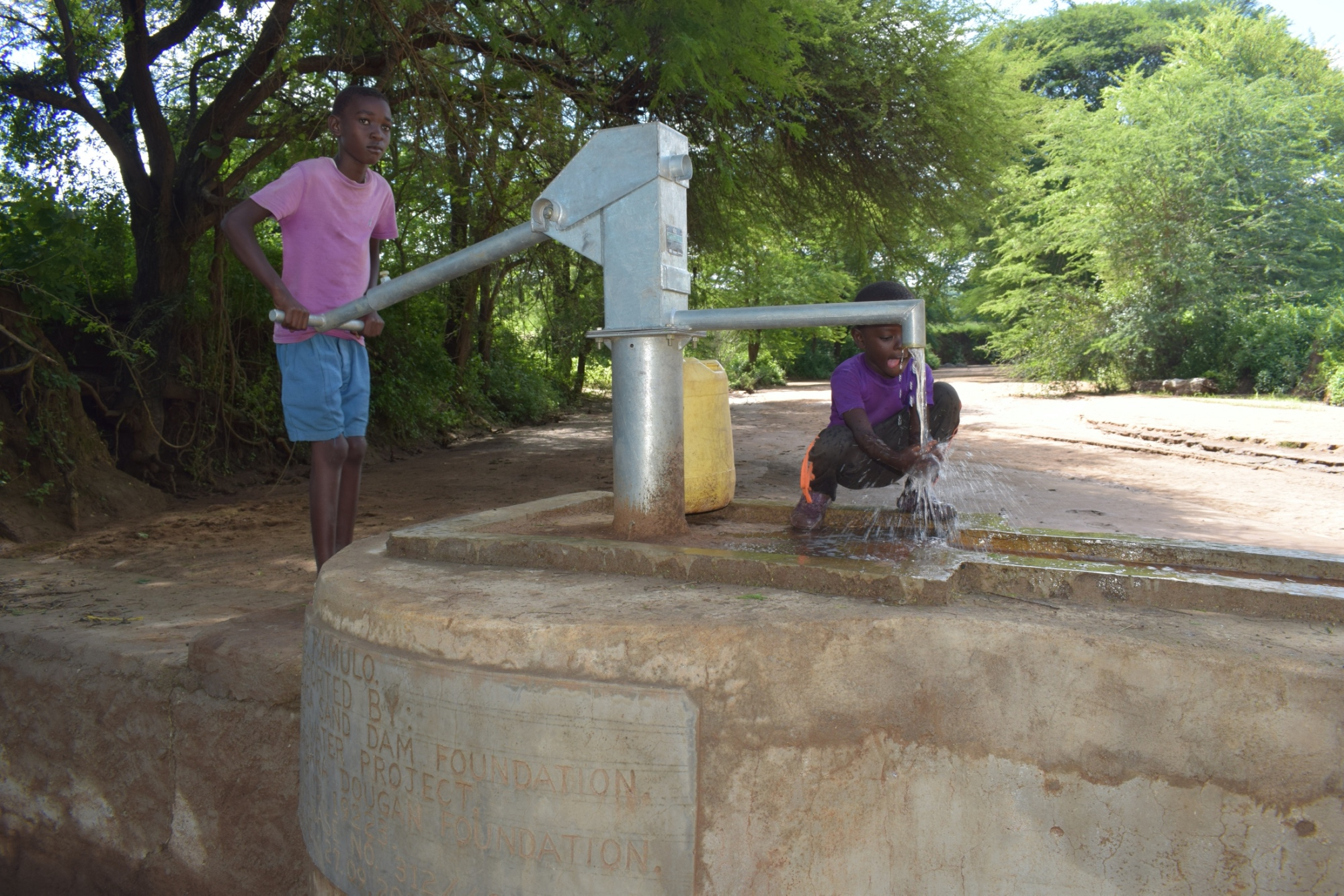 The Water Project : kenya19223-pumping-the-well
