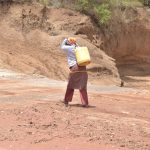 The Water Project: Kasioni Community C -  Carrying Water