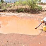 The Water Project: Kasioni Community C -  Scooping Water