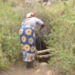 The Water Project: Nzimba Community -  Filling Bucket Down Open Well