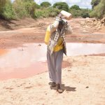 The Water Project: Nzimba Community -  Lifting Water Container After Filling