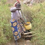 The Water Project: Nzimba Community A -  Lifting Water Out Of Unprotected Well
