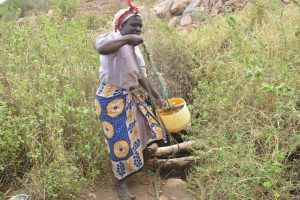 The Water Project:  Lifting Water Out Of Unprotected Well
