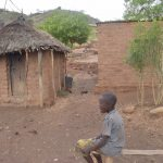 The Water Project: Nzimba Community -  Kid In The Compound