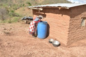 The Water Project:  Fetching Water From Storage Container