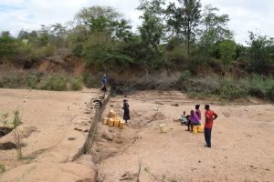 The Water Project:  Community Members Get Water At A River Scoop Hole