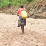 The Water Project: Mbitini Community A -  Carrying Water Home