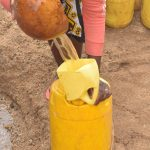 The Water Project: Mbitini Community A -  Funneling Water Into Container