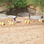 The Water Project: Mbitini Community -  People At The Scoop Hole