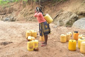 The Water Project:  Preparing To Walk Home With Water