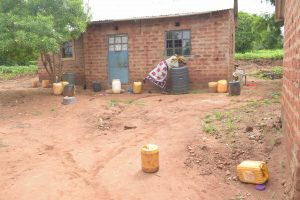 The Water Project:  Getting Water From Water Storage Containers