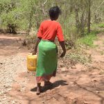 The Water Project: Kangalu Community B -  Carrying Water Home