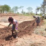 The Water Project: Kangalu Community B -  Community Members Already Preparing Land For Project