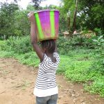 The Water Project: Lungi, Mamankie, DEC Mamankie Primary School -  Woman Carrying Water