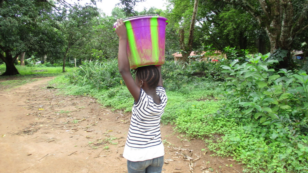 The Water Project : sierraleone19288-woman-carrying-water