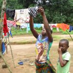 The Water Project: Lungi, Mamankie, DEC Mamankie Primary School -  Woman Drying Clothes