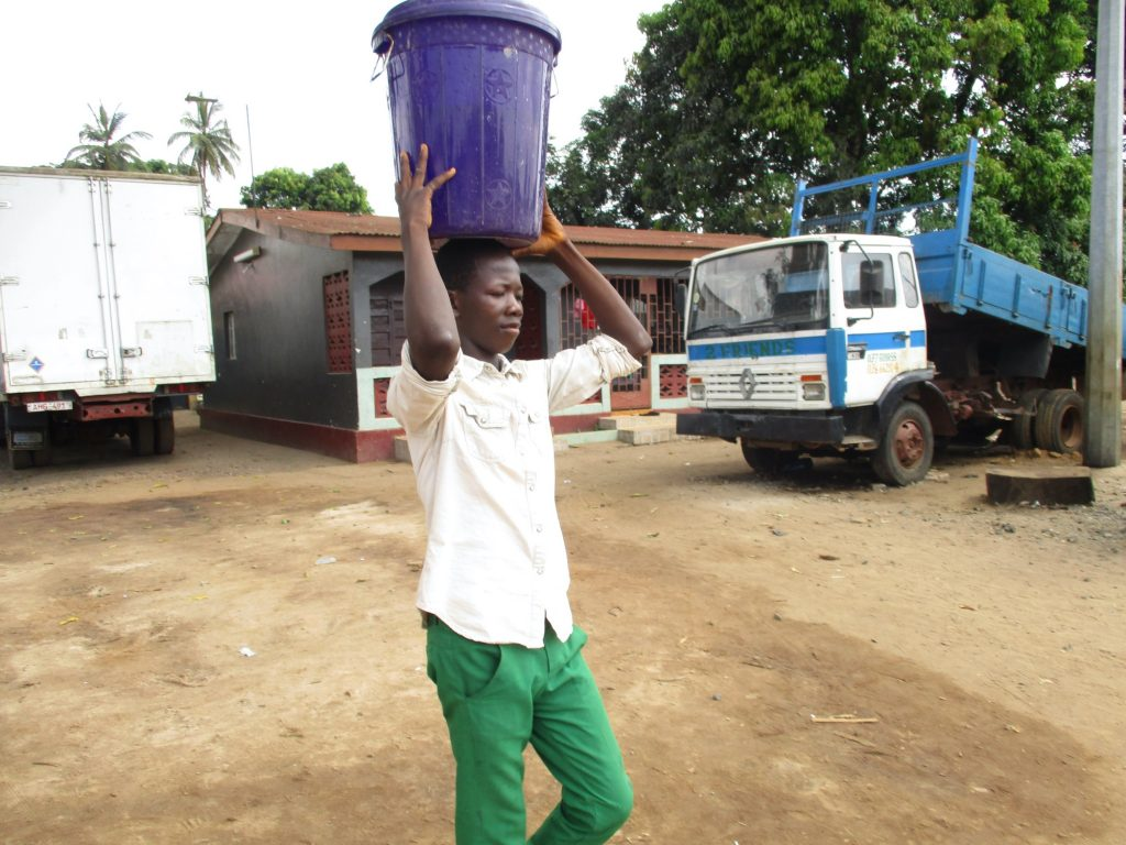 The Water Project : sierraleone20400-pupil-carrying-water-3