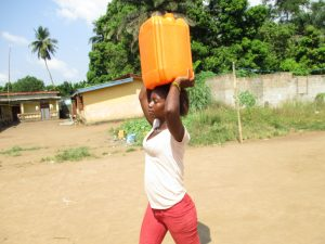 The Water Project:  Child Carrying Water
