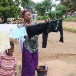 The Water Project: Lungi, Mahera, Mahera Health Clinic -  Lady Hanging Clothes