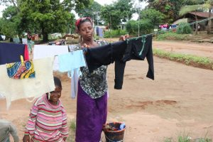 The Water Project:  Lady Hanging Clothes