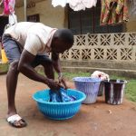 The Water Project: Lungi, Mahera, Mahera Health Clinic -  Washing Clothes