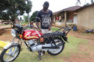 The Water Project:  Young Man Working On His Motorbike