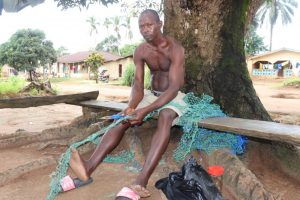 The Water Project:  Young Man Making Fishing Net