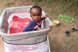 The Water Project:  Baby Sitting In Playpen
