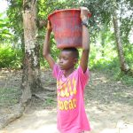 The Water Project: Lungi, Rosint, #26 Old Town Road -  Boy Carrying Water