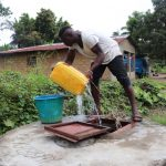 The Water Project: Lungi, Rosint, #26 Old Town Road -  Boy Fetching Water From Open Well
