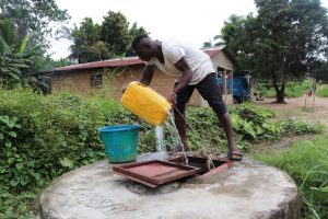 The Water Project:  Boy Fetching Water From Open Well