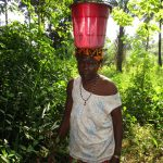 The Water Project: Lungi, Rosint, #26 Old Town Road -  Old Woman Carrying Water