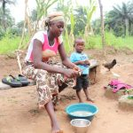 The Water Project: Lungi, Rosint, #26 Old Town Road -  Woman Cleaning Fish