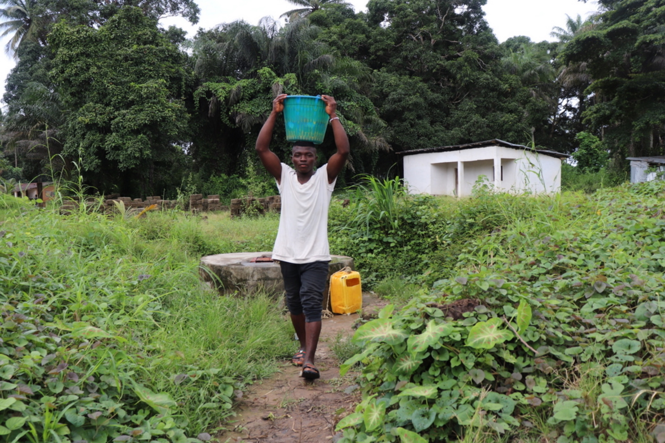 The Water Project : sierraleone20402-young-boy-carrying-water