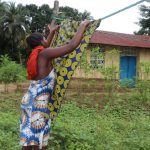 The Water Project: Lungi, Rosint, #26 Old Town Road -  Young Girl Hanging Clothes