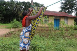 The Water Project:  Young Girl Hanging Clothes
