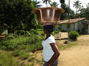 The Water Project:  Young Lady Selling Fish