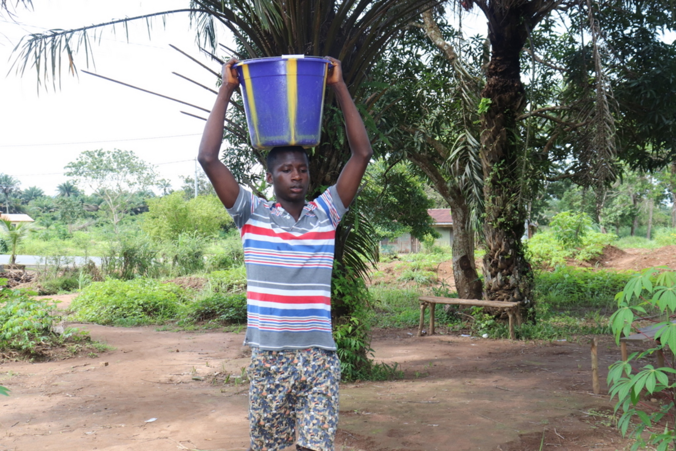 The Water Project : sierraleone20403-boy-carrying-water-1