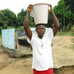 The Water Project: Lungi, New York, Robis, #7 Masata Lane -  Boy Carrying Water