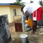 The Water Project: Lungi, New York, Robis, #7 Masata Lane -  Boy Collecting Water