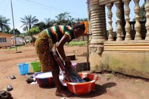 The Water Project:  Young Woman Washing Clothes