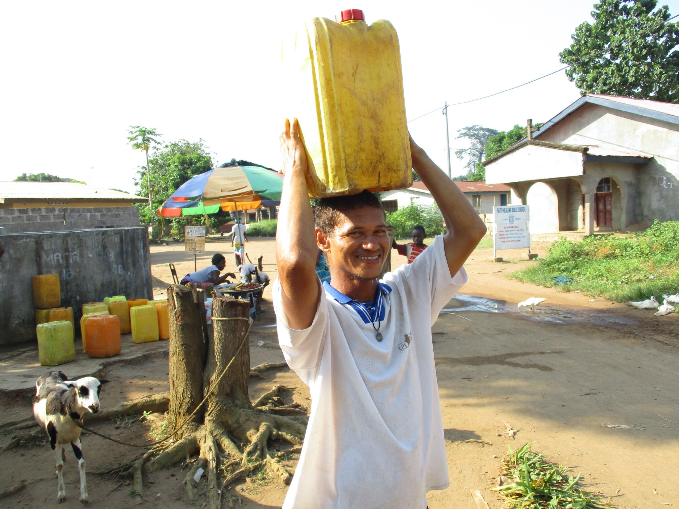 The Water Project : sierraleone20404-boy-carrying-water