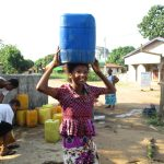 The Water Project: Lungi, New London, #10 Dankama Street -  Girl Carrying Water