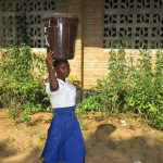 The Water Project: Lungi, Madina, St. Mary's Junior Secondary School -  Student Carrying Water