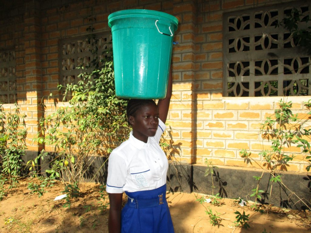 The Water Project : sierraleone20405-student-carrying-water-3