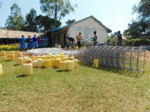The Water Project:  Busy Preparing Materials