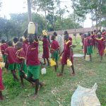 The Water Project: Nanganda Primary School -  Students Fetch Water For Construction