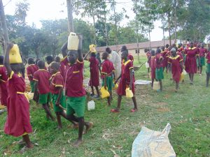 The Water Project:  Students Fetch Water For Construction